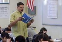 A Fresno Unified teacher reads aloud from a book.